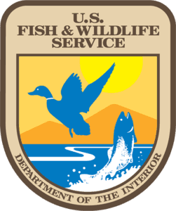 US Fish Wildlife Service Logo badge with duck and fish