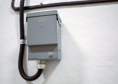 Grey power box outside mobile freezer rental