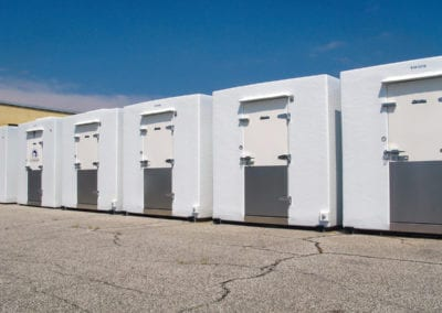 Line-up of five white polar leasing commercial refrigerators outside