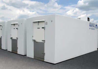 Polar Leasing white mobile freezing units on concrete with blue sky